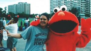 Jennifer (right) with Elmo at a community outreach event.